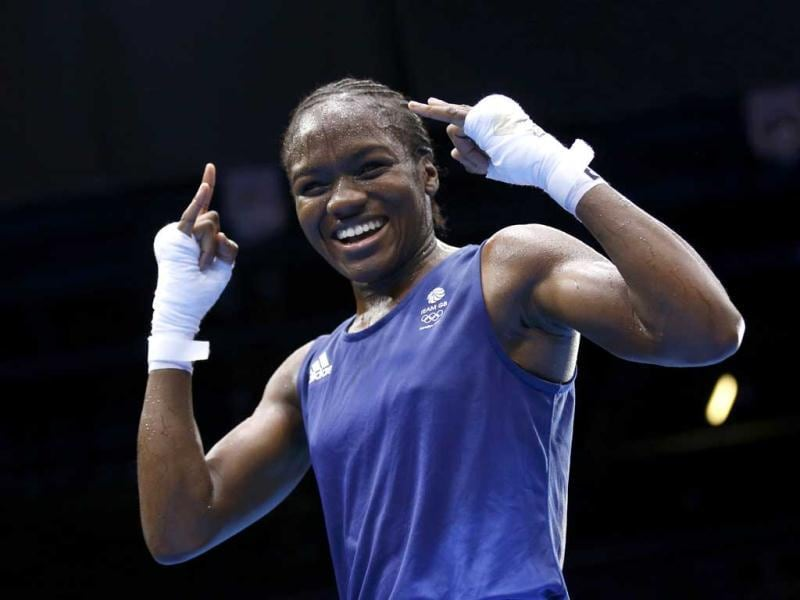 Britain's Nicola Adams reacts as she is declared the winner over China's Ren Cancan (not shown) during their Women's Fly (51kg) gold medal boxing match at the London Olympic Games. Reuters/Murad Sezer