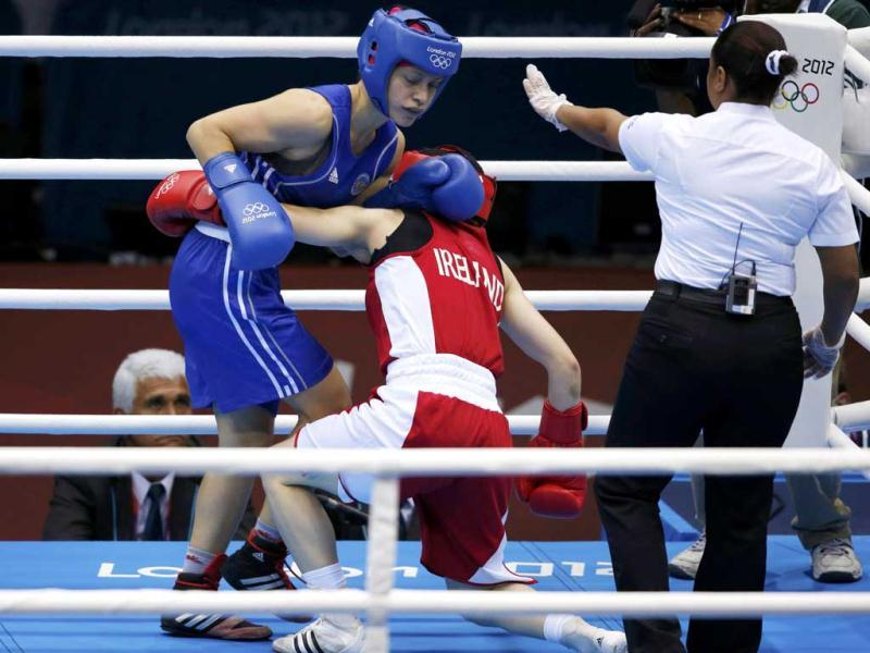 Ireland's Katie Taylor (C) fights Russia's Sofya Ochigava during their Women's Light (60kg) gold medal boxing match at the London Olympic Games. Reuters/Damir Sagolj