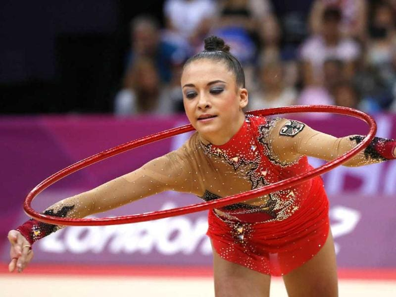 Germany's Jana Berezko-Marggrander performs her hoop program during the individual all-around qualifications of the rhythmic gymnastics event of the London Olympic Games. AFP/Thomas Coex