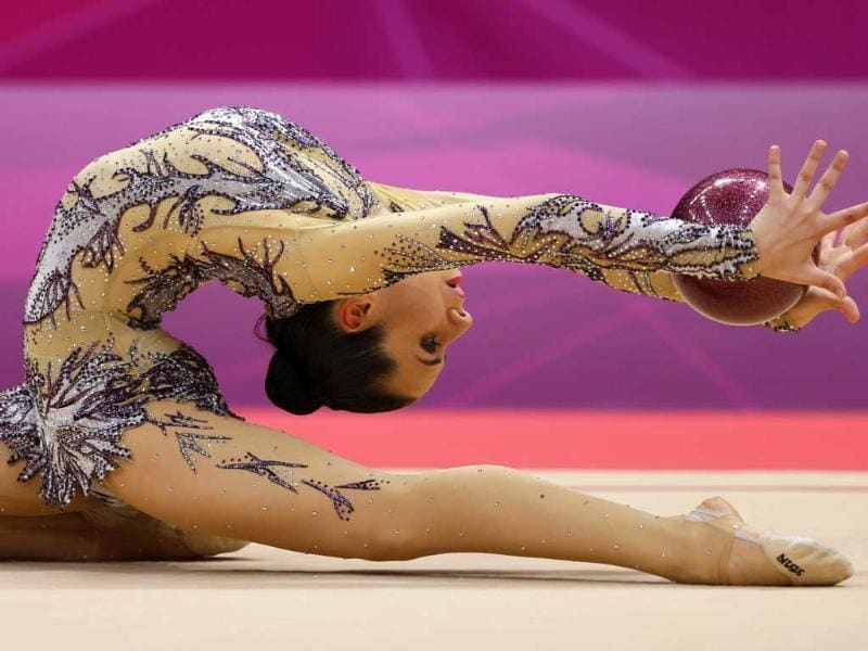 Egypt's Yasmine Mohmed Rostom performs during the rhythmic gymnastics individual all-around qualifications at the 2012 Summer Olympics in London. AP/Gregory Bull
