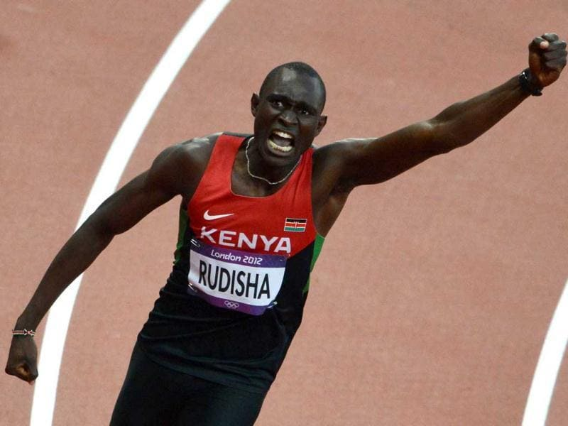 Kenya's David Lekuta Rudisha celebrates after winning and breaking the world record in the men's 800m final at the athletics event during the London 2012 Olympic Games. AFP Photo/Jewel Samad