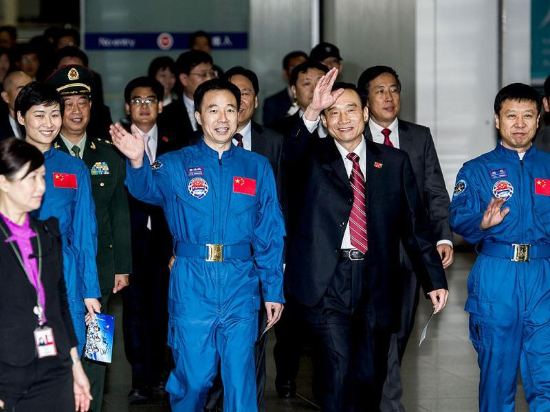 Astronauts of the Tiangong-1/Shenzhou-9 Manned Space Docking and Rendezvous Mission delegation arrive at Hong Kong's international airport. (AFP Photo)