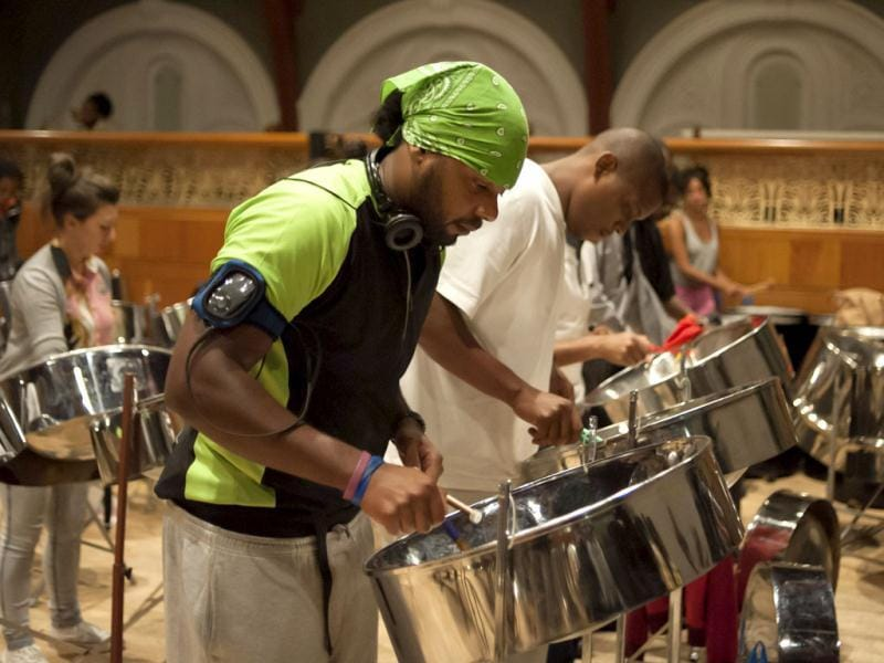 Members of The Notting Hill Steel Band practice in The Tabernacle, Ladbroke Grove, London.
