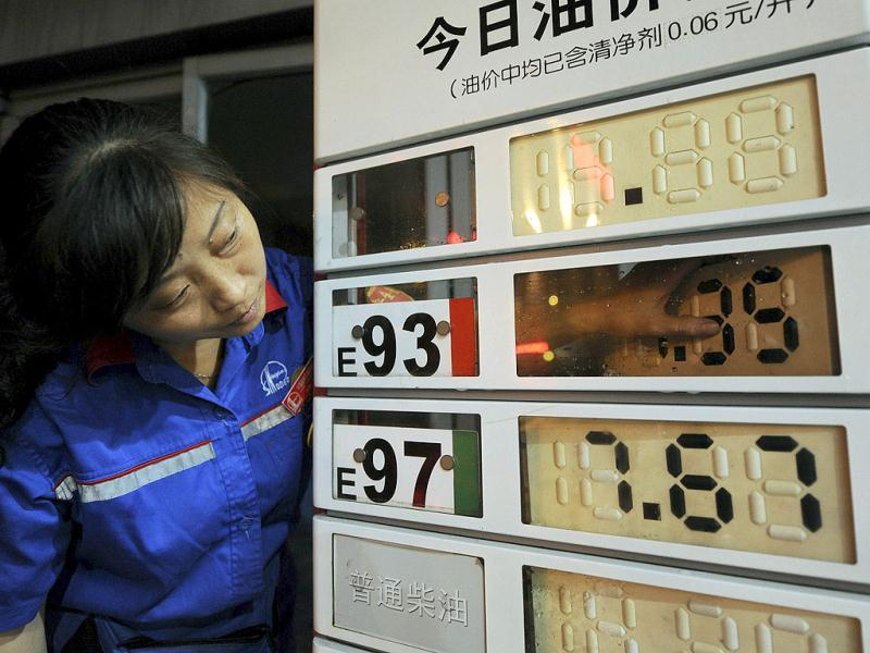 An employee updates fuel prices at a gas station in Hefei. China, the world's second-largest fuel user, raised retail prices of gasoline and diesel between 4% and 5% from Friday to track climbing crude prices. (Reuters)