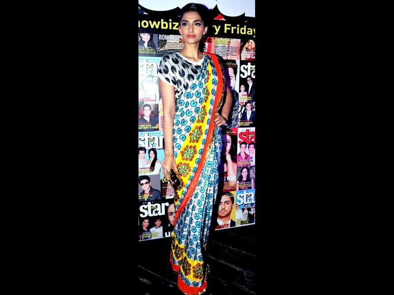 Sonam Kapoor looks stunning in a pacman-print sari. She's truly a style diva! (Photo: AFP)