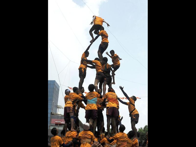 Indian Hindu devotees form a human pyramid to break the dahi-handi suspended in the air during celebrations of Janmashtami, which marks the birth of Hindu God Lord Krishna. (AFP /Punit Paranjpe)