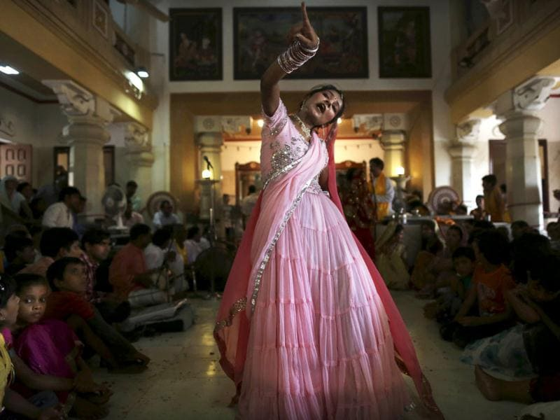 An Indian girl in traditional dress dances during the Janmashtami festival celebrations at a temple in New Delhi, India. Janmashtami is the festival that marks the birth of Hindu God Krishna.(AP/Kevin Frayer)