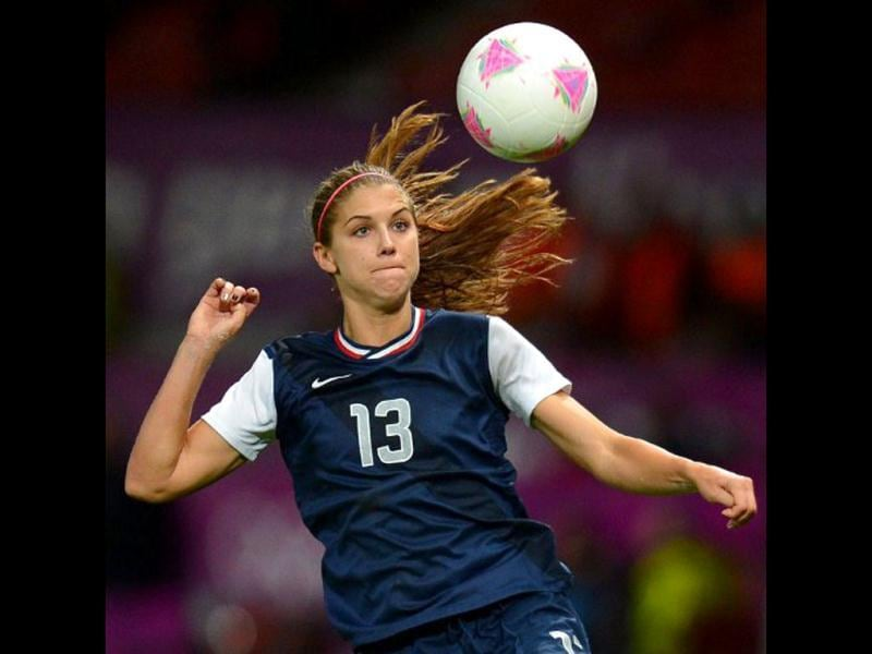 US forward Alex Morgan controls the ball during the London 2012 Olympic Games semi final match against Canada. Keep an eye out for this American beauty at the 2012 Olympic Soccer Championship! AFP/Andrew Yates