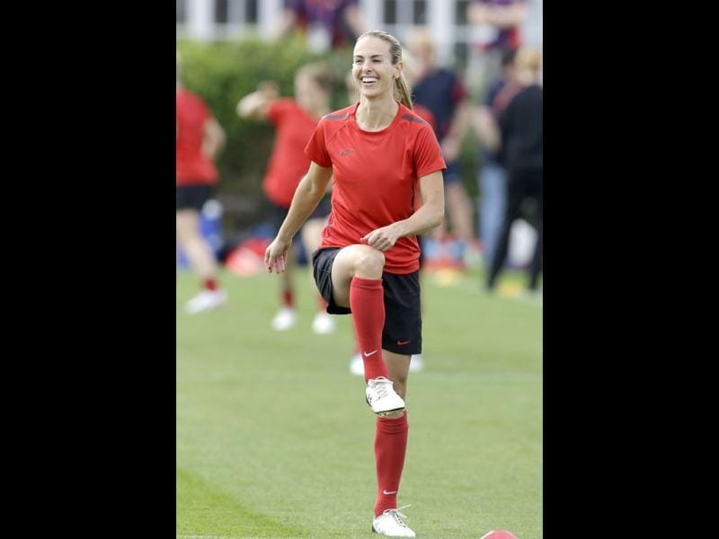 One look at Heather Mitts and you can feel the temperatures soaring. Mitts, of the United States women's soccer team, trains in London in this photo. AP/Lefteris Pitarakis
