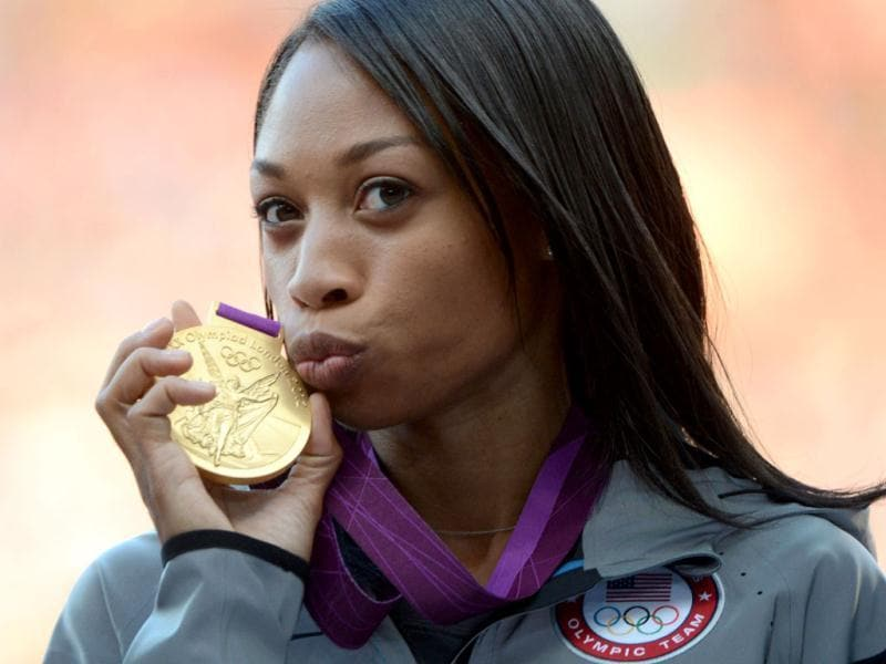 US' African American gold medalist sprinter Allyson Felix poses on the podium of the women's 200m at the athletics event of the 2012 Olympic Games in London. AFP/Johannes Eisele