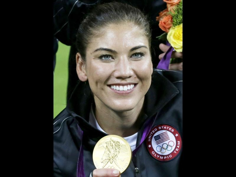 With the perfect combination of looks and talent, United States goalkeeper Hope Solo shows her gold medal after a match against Japan at the 2012 Summer Olympics, in London. AP/Julie Jacobson
