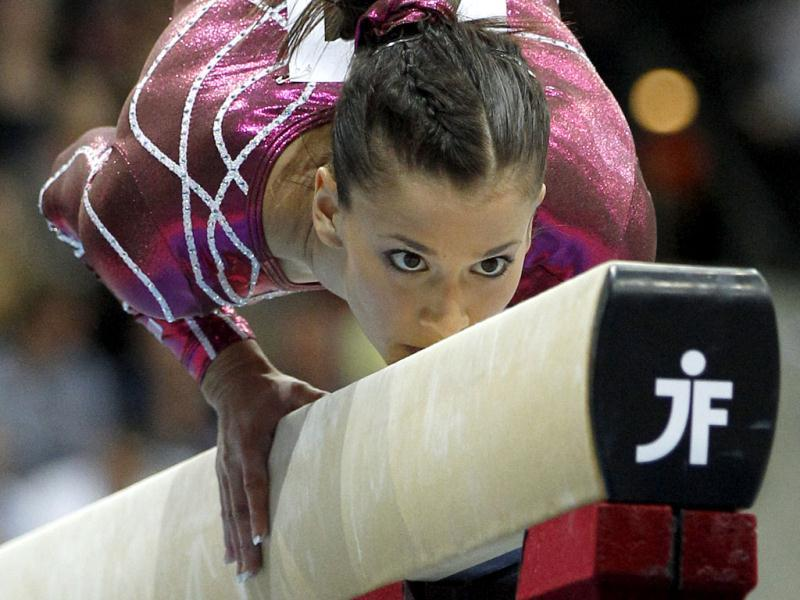 American gymnast Alicia Sacramone not only wows crowds with her drop-dead gorgeous looks, but also manages to score perfect 10s at the vault every time. Reuters/Jerry Lampen