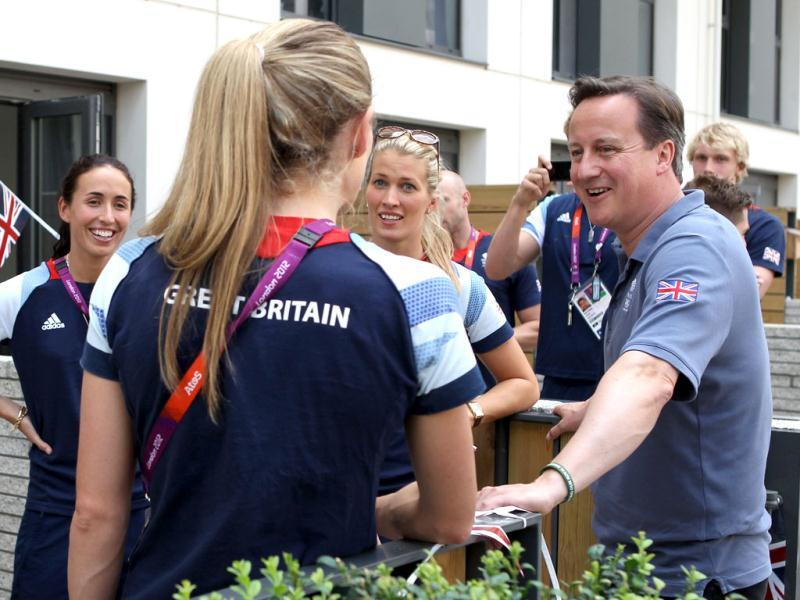 British Prime Minister David Cameron talks to Team GB athletes during a visit to the Olympic Village on Day 14 of the London 2012 Olympic Games in London. AFP/Scott Halleran