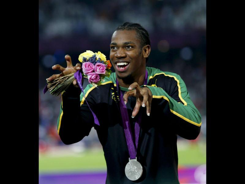 Silver medallist Yohan Blake of Jamaica gestures during the presentation ceremony for the men's 200m event at the London 2012 Olympic Games at the Olympic Stadium. (Reuters/Eddie Keogh)