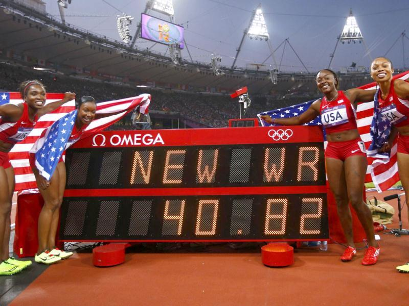 Members of the US team pose with their national flags by the scoreboard after winning the women's 4x100m relay final during the London 2012 Olympic Games at the Olympic Stadium. The team, made up of (from L to R) Tianna Madison, Carmelita Jeter, Bianca Knight and Allyson Felix, set a new world record with a time of 40.82 seconds. (Reuters/Kai Pfaffenbach)