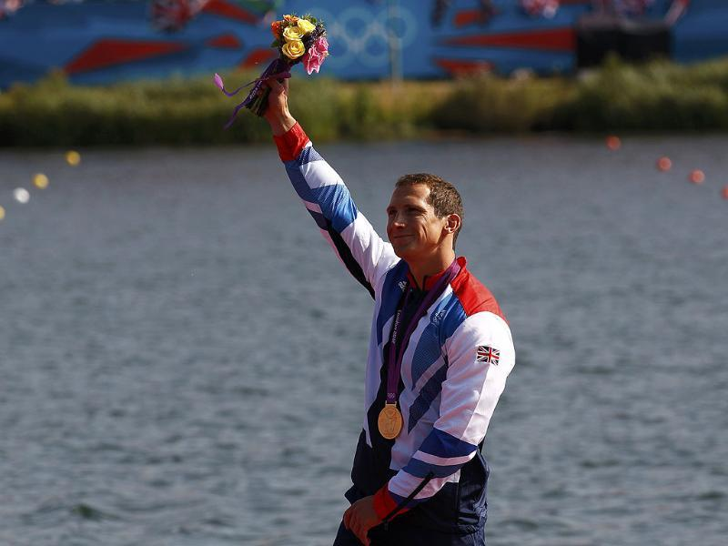 Gold medallist Britain's Ed Mckeever celebrates on the podium during the victory ceremony for the men's kayak single (K1) 200m final at the Eton Dorney during the London 2012 Olympic Games. Reuters/Jim Young