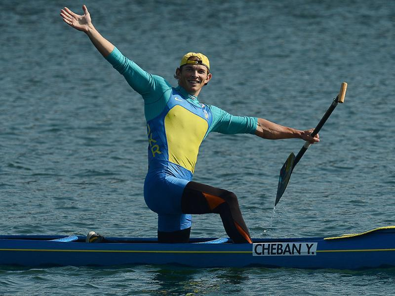 Ukraine's Iurii Cheban celebrates after winning the gold medal in the canoe single (C1) 200m men's final 'A' during the London 2012 Olympic Games, at Eton Dorney Rowing Centre in Eton, west of London. AFP/Francisco Leong