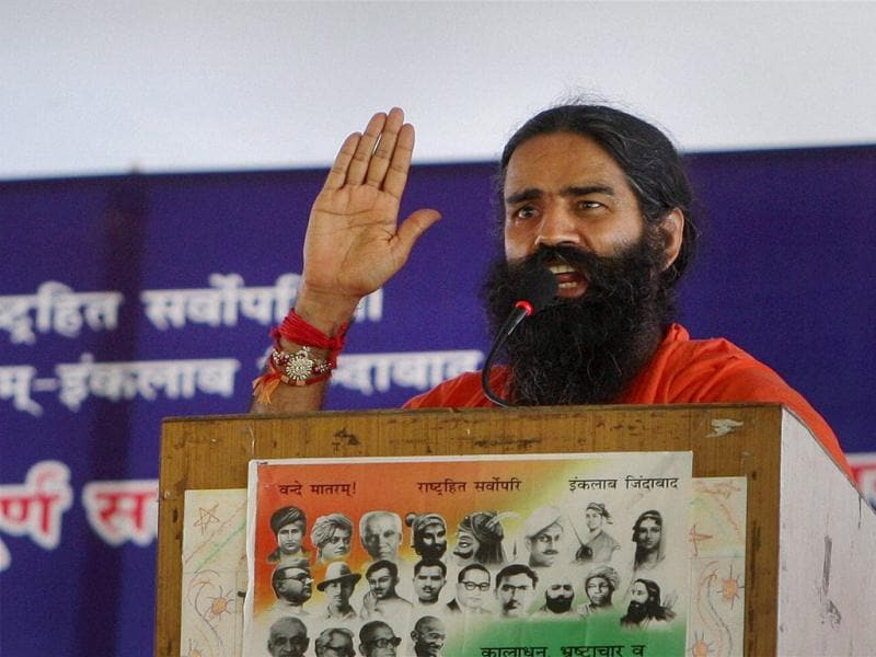 Yoga guru Baba Ramdev addresses his supporters on the third day of his fast against black money and corruption at Ramlila Ground in New Delhi. PTI Photo/Vijay Kumar Joshi