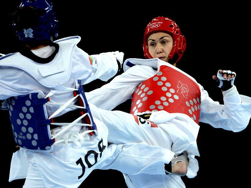 Jordan's Nadin Dawani (blue) fights against Ukraine's Maryna Konieva during their women's taekwondo bout in the + 67 kg category as part of the London 2012 Olympic games at the ExCel centre. AFP/Toshifumi Kitamura