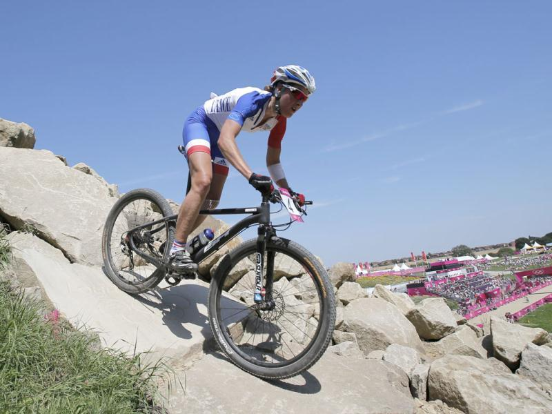 Julie Bresset of France competes in the Mountain Bike Cycling women's race, at the 2012 Olympics at Hadleigh Farm in Essex, England. AP Photo/Christophe Ena
