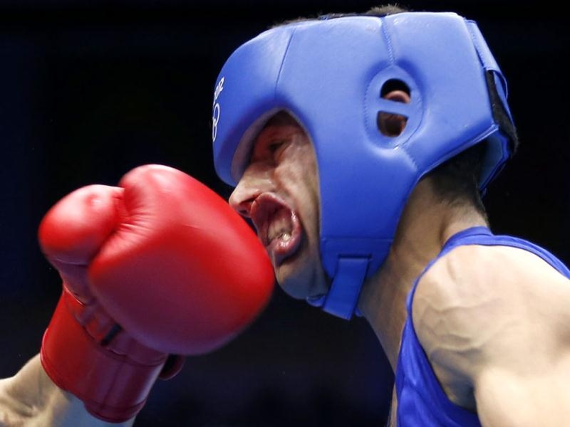 Nordine Oubaali of France (L) fights against Afghanistan's Ajmal Faisal in the men's Fly (52kg) Round of 32 boxing match at the ExCeL venue during the London 2012 Olympic Games. Reuters/Murad Sezer