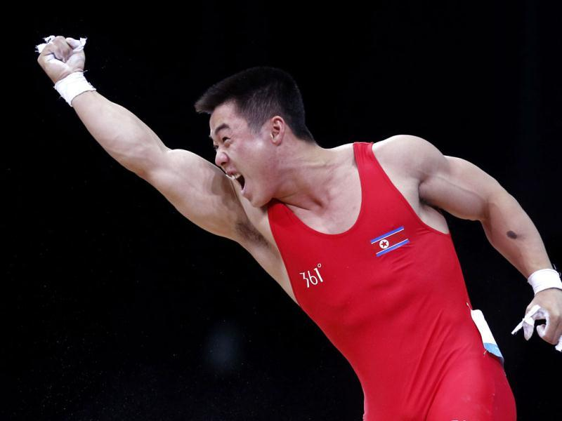 North Korea's Un Guk Kim reacts after successful lift on the men's 62Kg Group A weightlifting competition at the London 2012 Olympic Games. Reuters/Dominic Ebenbichler