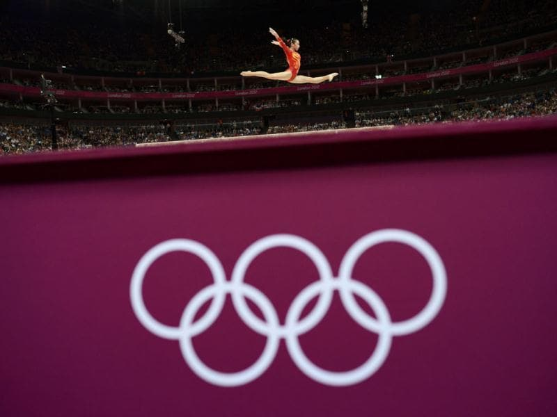China's Huang Qiushuang performs on the balance beam during the women's gymnastics qualification at the North Greenwich Arena during the London 2012 Olympic Games. Reuters/Dylan Martinez