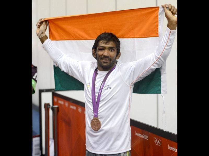 Yogeshwar Dutt celebrates after winning the bronze medal in the men's 60-kg freestyle wrestling competition at the 2012 Summer Olympics. PTI/Manvender Vashist