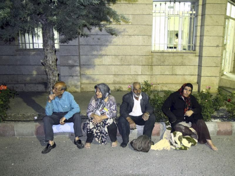 Residents of the city of Varzaqan sit at the side of a street after an earthquake in northwestern Iran. AP/Kazem Yousefi