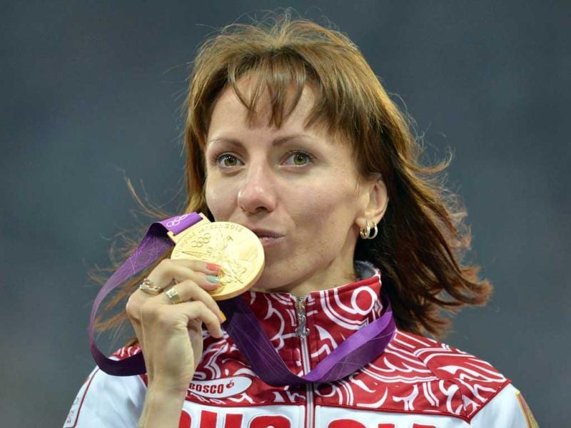 Russia's gold medalist Mariya Savinova kisses her medal on the podium of the women's 800m at the athletics event of the London 2012 Olympic Games in London. AFP Photo