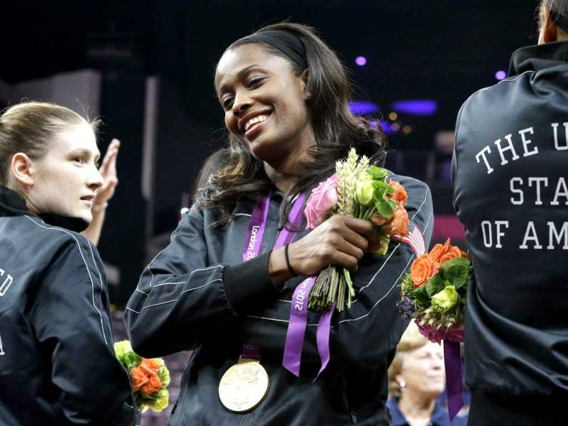 United States' Swin Cash, center, celebrates with teammates after receiving her gold medal after defeating France in a women's gold medal basketball game at the 2012 Summer Olympics in London. AP Photo