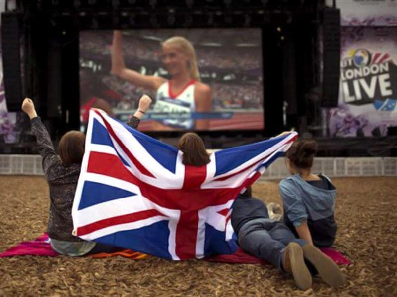 British supporters react as they watch a broadcast of the woman's 1500-meter semifinals on a screen at Hyde Park in London during 2012 Summer Olympics, in London. (AP Photo/Emilio Morenatti)