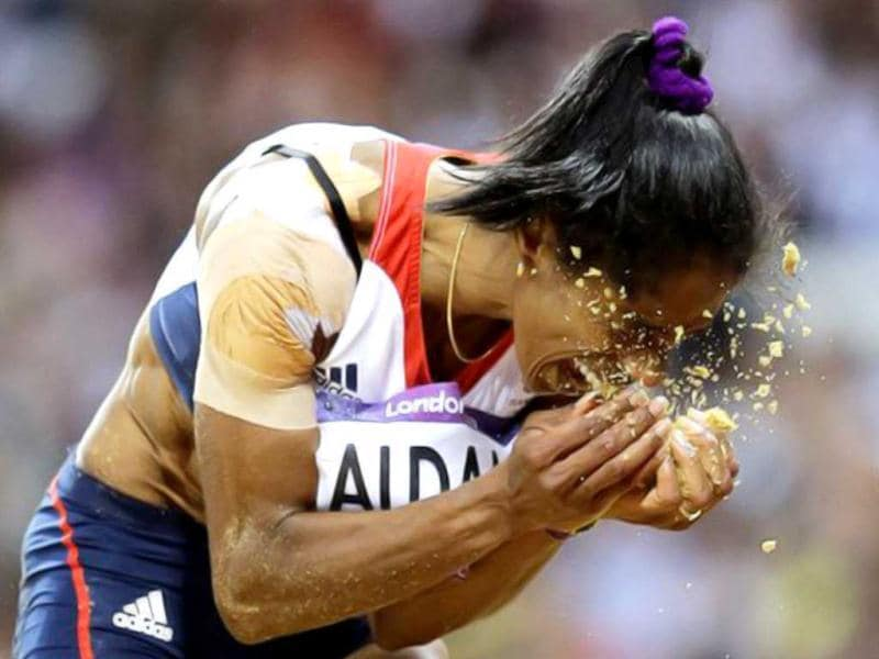 Britain's Yamile Aldama reacts during the women's triple jump final during the athletics in the Olympic Stadium at the 2012 Summer Olympics, London. (AP Photo/David J. Phillip )