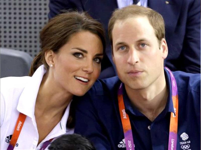 Prince William, right, and wife Kate, Duke and Duchess of Cambridge, watch track cycling at the velodrome during the 2012 Summer Olympics in London. (AP Photo/Matt Rourke)