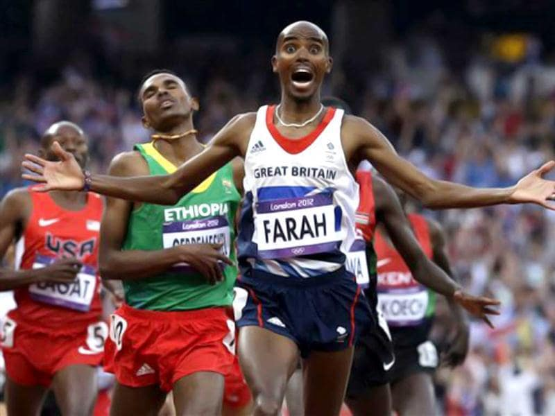 Britain's Mohamed Farah celebrates as he crosses the finish line to win the men's 5000-meter final during the athletics in the Olympic Stadium at the 2012 Summer Olympics, London.(AP Photo/Anja Niedringhaus)