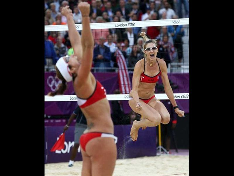 United States' Misty May-Treanor, left, and Kerri Walsh Jennings celebrate after defeating China in their semifinal women's beach volleyball match at the 2012 Summer Olympics, in London. (AP Photo/Petr David Josek)