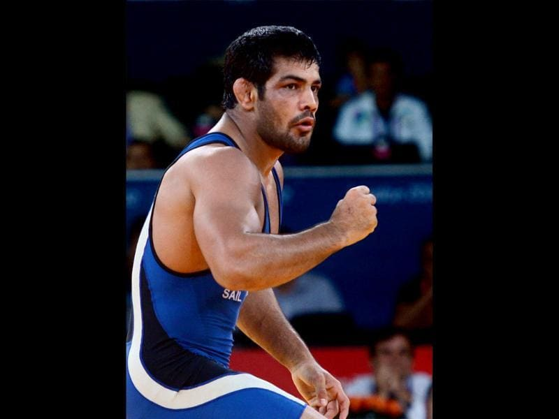 Sushil Kumar celebrates win against Kazakhistan's Akzhurek Tanatarov in their Men's 66kg Freestyle Semifinal match at the Olympic Games in London. PTI/Manvender Vashist