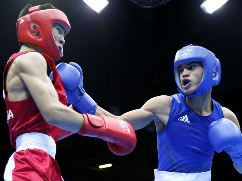 Tugstsogt Nyambayar of Mongolia (in red) defends against Robeisy Ramirez Carrazana of Cuba (in blue) during the Flyweight (52kg) boxing finals of the 2012 London Olympic Games at the ExCel Arena in London. AFP Photo/Jack Guez