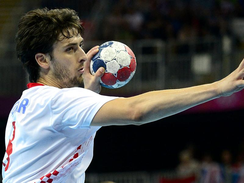 Croatia's rightback Marko Kopljar attempts a shot during the men's bronze medal handball match Hungary vs Croatia for the London 2012 Olympics Games, at the Basketball Arena in London. AFP Photo/Javier Soriano