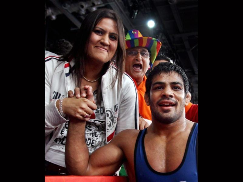 Sushil Kumar celebrates win with his spouse Savy Kumar, after defeating Kazakhstan's Akzhurek Tanatarov in their Men's 66kg Freestyle semifinal match at the Olympic Games in London. PTI/Manvender Vashist