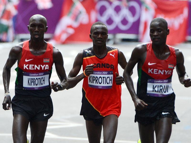 (From L) Kenya's Wilson Kipsang Kiprotich, Uganda's Stephen Kiprotich and Kenya's Abel Kirui run in the athletics event men's marathon during the London 2012 Olympic Games in London. AFP/Olivier Morin