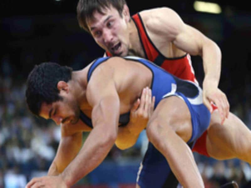 Sushil Kumar and Kazakhstan wrestler Akzhurek Tanatarov during their match on Sunday. Kumar went on to win the match and entered the finals. (Reuters)