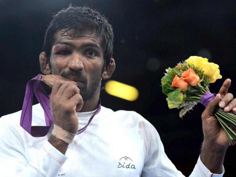 Yogeshwar Dutt poses with bronze medal during the medal ceremony of Men's 60kg Freestyle at the Olympic Games in London. PTI Photo/Manvender Vashist