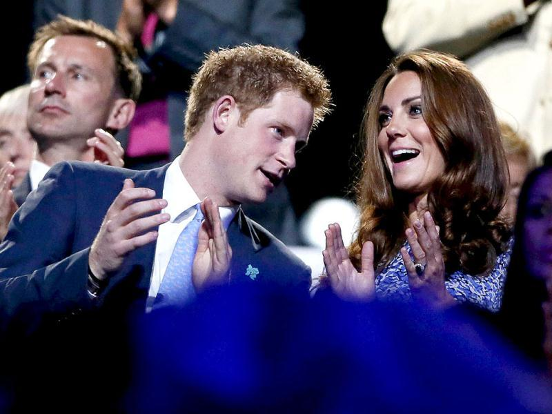 Britain's Prince Harry (L) and Dutchess of Cambridge Kate Middleton (R) applaud as they view the closing ceremony of the London 2012 Olympic Games at the Olympic Stadium. REUTERS