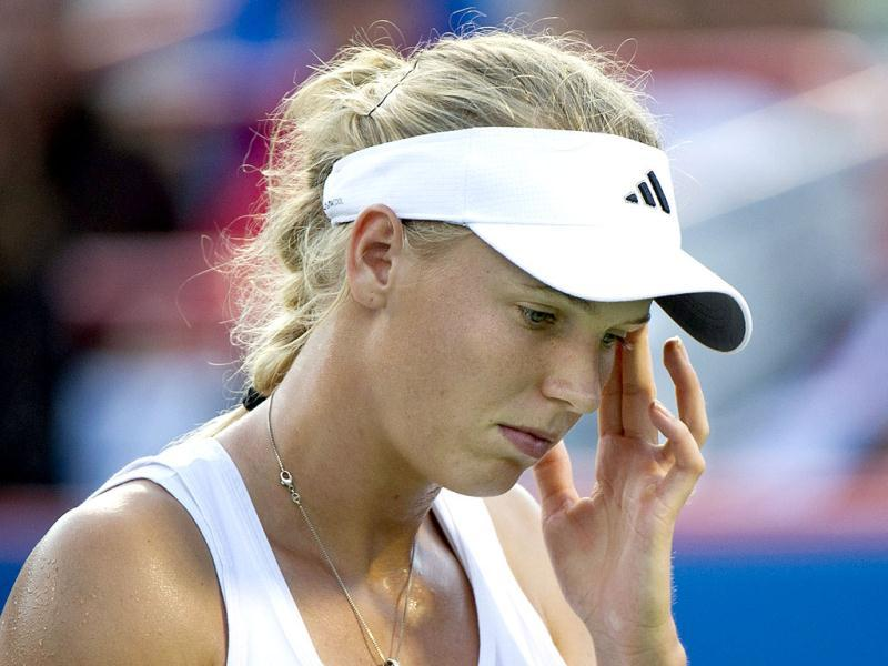 Caroline Wozniacki of Denmark reacts as she faces Petra Kvitova of the Czech Republic during semi-final of play at the Rogers Cup tennis tournament in Montreal. Kvitova won 3-6, 6-2, 6-3 to face Li Na from China in the final. (AP Photo/The Canadian Press, Paul Chiasson)