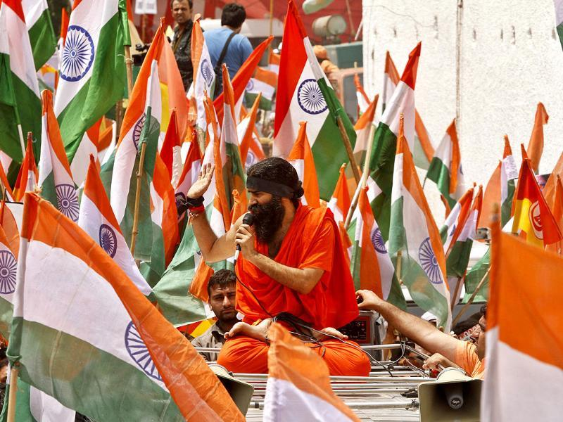 Indian yoga guru Baba Ramdev talks to his supporters sitting on a jeep as he and his supporters march to India's Parliament to intensify an anti-corruption protest and press for a change of government in New Delhi. AP/Rajesh Kumar Singh