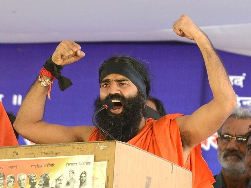 Yoga guru Baba Ramdev gestures before starting his march to Parliament in New Delhi. AFP photo/Prakash Singh