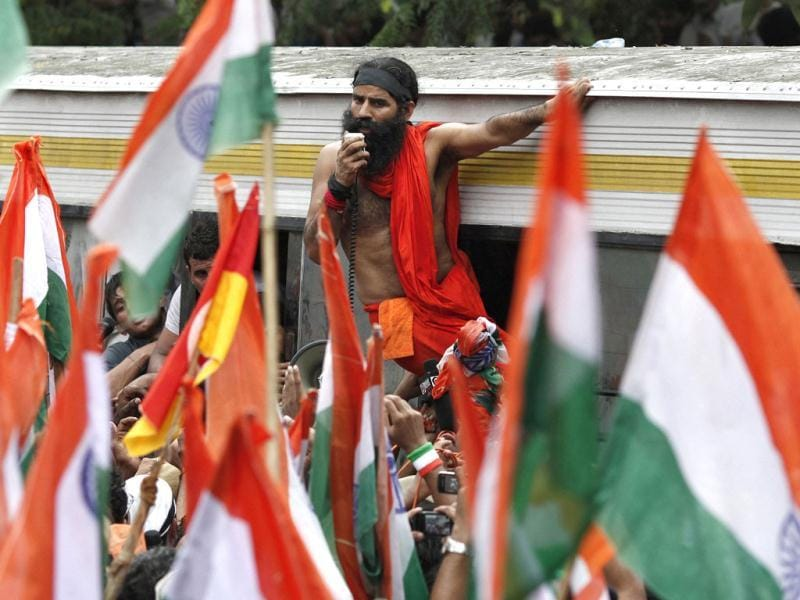 Yoga guru Baba Ramdev addresses his supporters from a bus after he was detained by police during a protest march against corruption in New Delhi. Reuters photo/Adnan Abidi