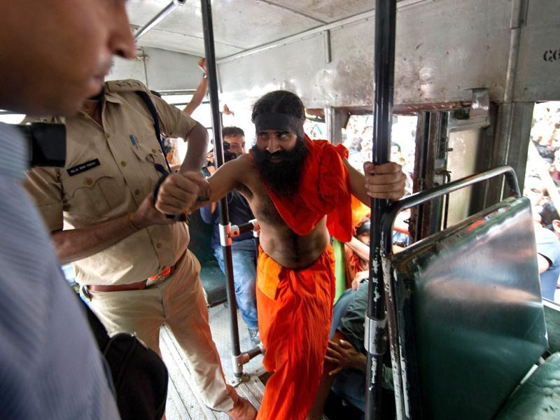 Yoga guru Baba Ramdev is taken onto a bus after his arrest in New Delhi. AFP photo/Prakash Singh