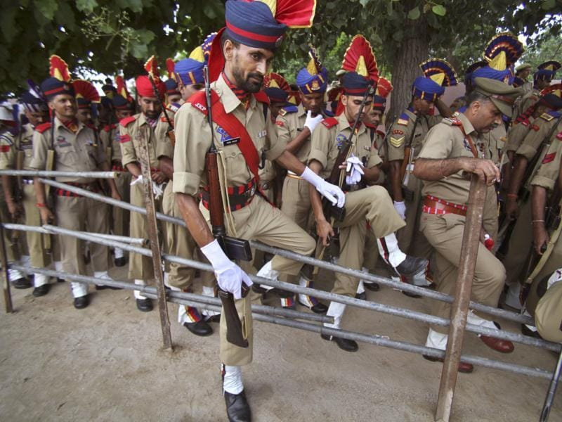 Jammu and Kashmir policemen walk after Independence Day celebration rehearsals in Jammu. AP Photo/Channi Anand